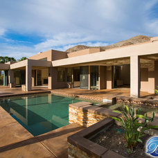 Contemporary Pool by Beneficial Construction Group
