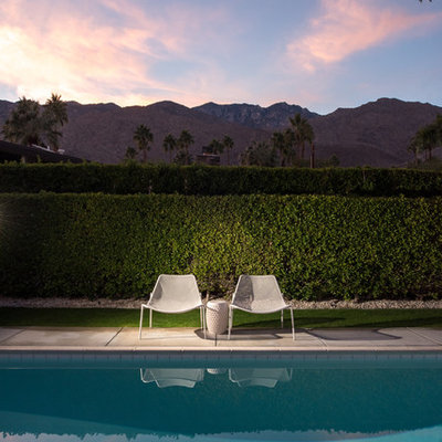 Inspiration for a mid-sized mid-century modern backyard rectangular pool remodel in San Diego
