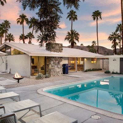Mid-sized mid-century modern backyard rectangular pool photo in San Diego