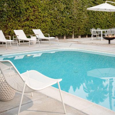 Mid-sized 1950s backyard rectangular pool photo in San Diego