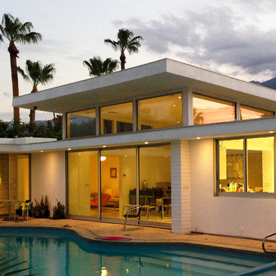Hot tub - mid-sized 1960s courtyard concrete and custom-shaped hot tub idea in Los Angeles