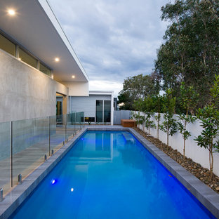 Pool - large contemporary backyard stone and rectangular pool idea in Sunshine Coast