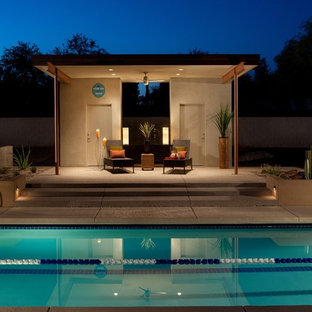 Inspiration for a contemporary rectangular swimming pool in Phoenix with a pool house.