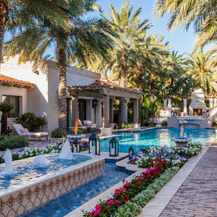 Inspiration for a mediterranean courtyard brick and rectangular lap pool fountain remodel in Phoenix