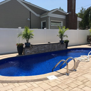Inspiration for a mid-sized timeless backyard tile and kidney-shaped aboveground pool remodel in New York