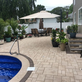 Pool - mid-sized traditional backyard tile and kidney-shaped aboveground pool idea in New York