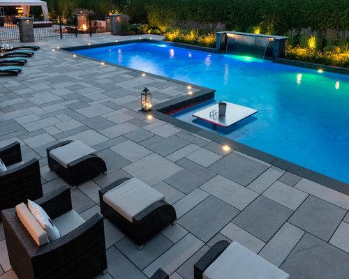 piscine moderne avec une dalle de b ton photos et id es. Black Bedroom Furniture Sets. Home Design Ideas