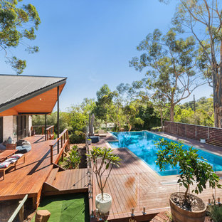Contemporary backyard rectangular lap pool in Perth with decking.