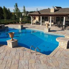Traditional Pool by Barnett Construction