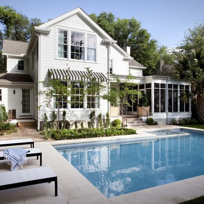 Pool - traditional backyard stamped concrete and l-shaped pool idea in Austin