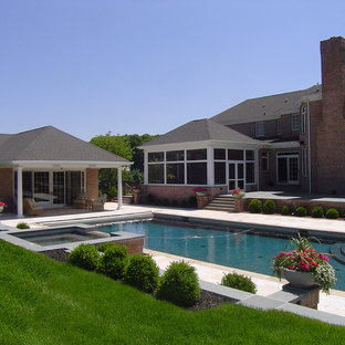 Example of a huge classic backyard stone and rectangular hot tub design in Philadelphia