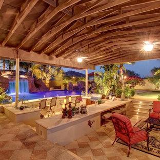 Imagen de piscina con tobogán mediterránea, grande, a medida, en patio trasero