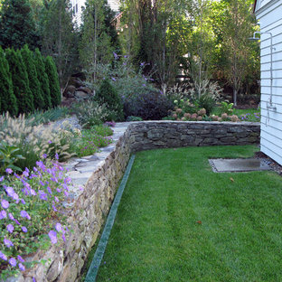 Design ideas for a country side yard pool in New York with a pool house and natural stone pavers.