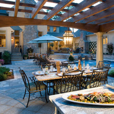 Traditional Pool by Guidi Homes