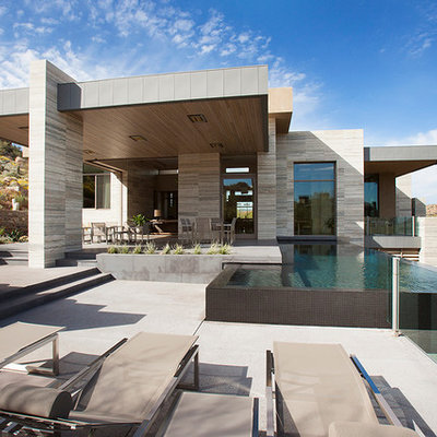 Inspiration for a huge modern backyard rectangular and concrete infinity pool remodel in Phoenix