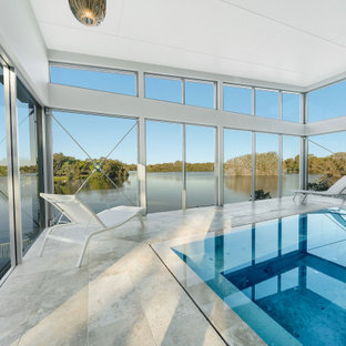 Photo of a contemporary rectangular pool in Gold Coast - Tweed with tile.
