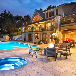 Inspiration for a large mediterranean backyard concrete paver and rectangular lap hot tub remodel in Minneapolis