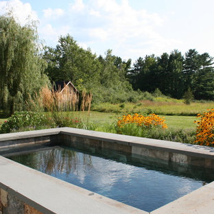 Small country backyard rectangular pool in Boston with natural stone pavers.