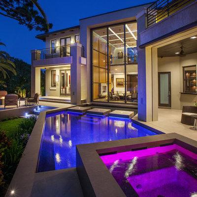 Trendy side yard custom-shaped pool photo in Orlando