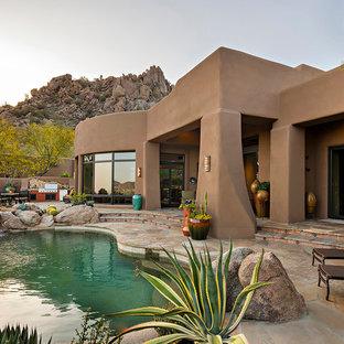 Southwest backyard custom-shaped natural pool fountain photo in Phoenix