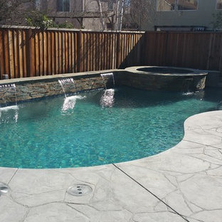 Inspiration for a mid-sized timeless backyard stamped concrete and kidney-shaped hot tub remodel in San Francisco