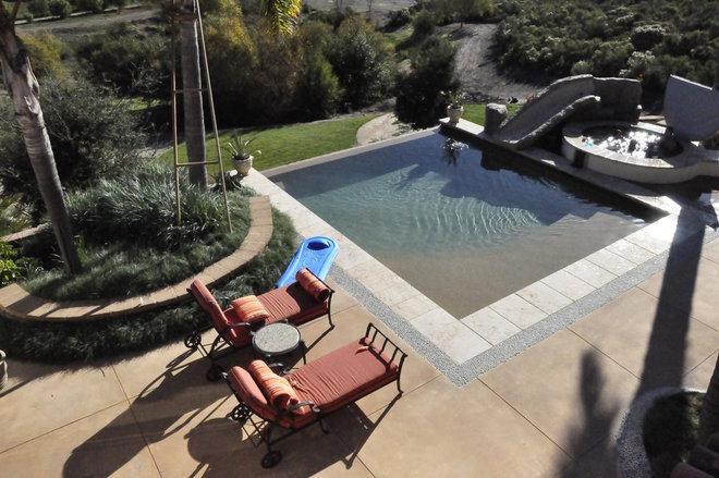 Contemporary Pool by Jeffrey Gordon Smith Landscape Architecture