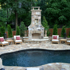 Traditional Pool by Artistic Landscapes