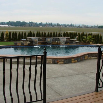 Inspiration for a large mediterranean backyard concrete and kidney-shaped aboveground pool fountain remodel in Portland