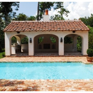 Large mediterranean backyard rectangular lap pool in Other with brick pavers and a hot tub.