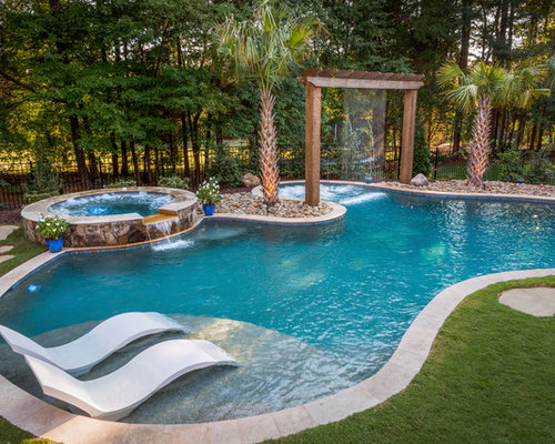 example of a classic backyard custom shaped hot tub design in charlotte