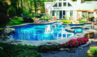 Pool and spa with a sunken fire pit.