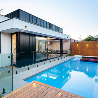 Design ideas for a contemporary backyard rectangular lap pool in Adelaide with a hot tub and decking.