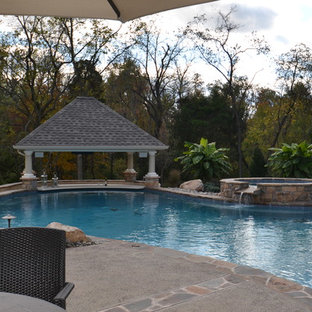 Inspiration for a large timeless backyard decomposed granite and custom-shaped natural hot tub remodel in Philadelphia