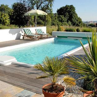 Mittelgroßer Mediterraner Pool in rechteckiger Form mit Dielen in Sonstige