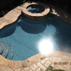 traditional pool by Construction Owl