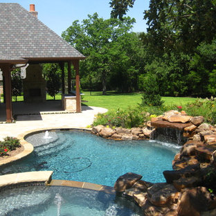 Inspiration for a large timeless backyard concrete paver and kidney-shaped lap pool fountain remodel in Dallas