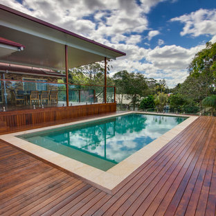 Inspiration for a large transitional backyard pool in Gold Coast - Tweed.