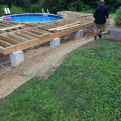 Example of a mid-sized backyard custom-shaped aboveground pool design in Providence