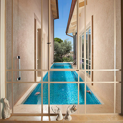 Inspiration for a contemporary courtyard lap pool remodel in Other