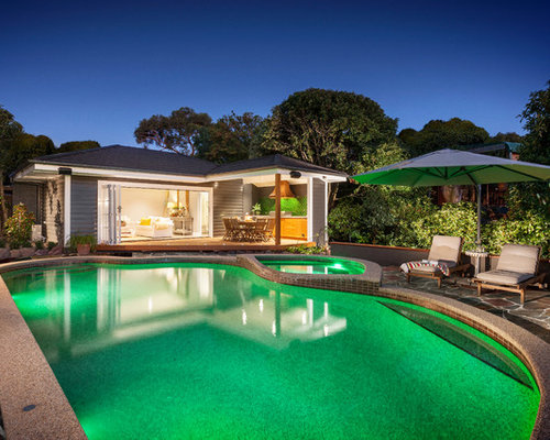Mid-sized coastal backyard stone and custom-shaped pool house photo in  Melbourne