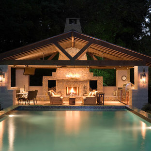 Inspiration for a large contemporary back rectangular swimming pool in Houston with a pool house and stamped concrete.