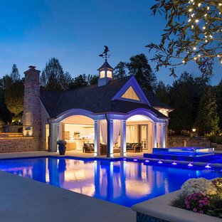 Pool house - mediterranean backyard concrete and rectangular pool house idea in Cleveland