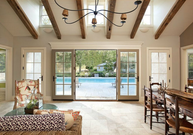 Traditional Pool by Nautilus Architects LLC