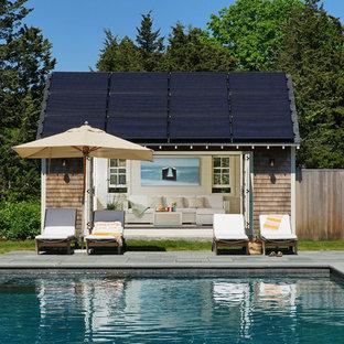 Pool house - huge farmhouse backyard stone and rectangular pool house idea in Boston