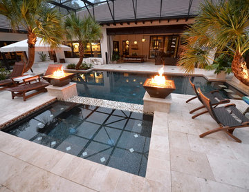 Pool in Lake Mary, FL with sun shelf, swim up bar, fire bowl, floor lights