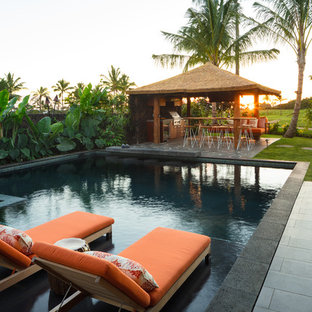 Inspiration for a large tropical backyard tile and rectangular lap hot tub remodel in Hawaii