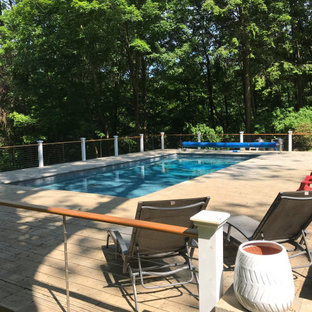 Design ideas for a small shabby-chic style backyard rectangular pool in New York with concrete pavers.