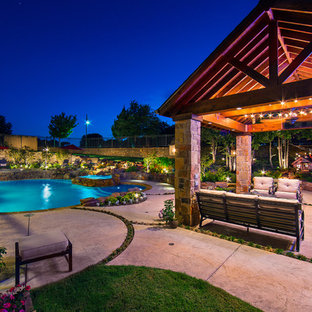 Inspiration for a mid-sized rustic backyard custom-shaped natural hot tub remodel in Dallas