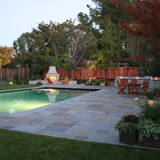 Traditional Pool by Terra Ferma Landscapes