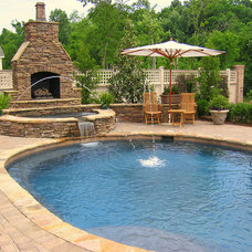Traditional Pool by Elements Landscape